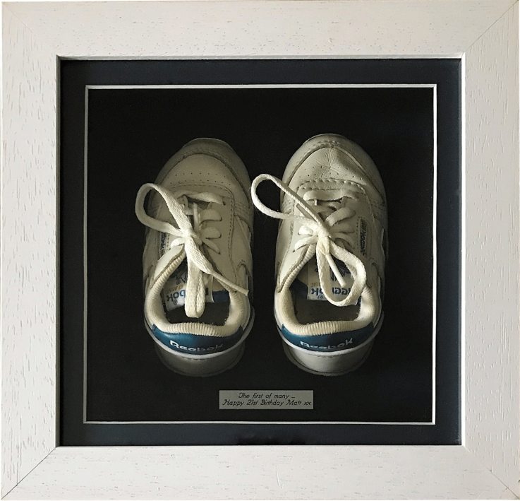 Baby's trainers in box frame