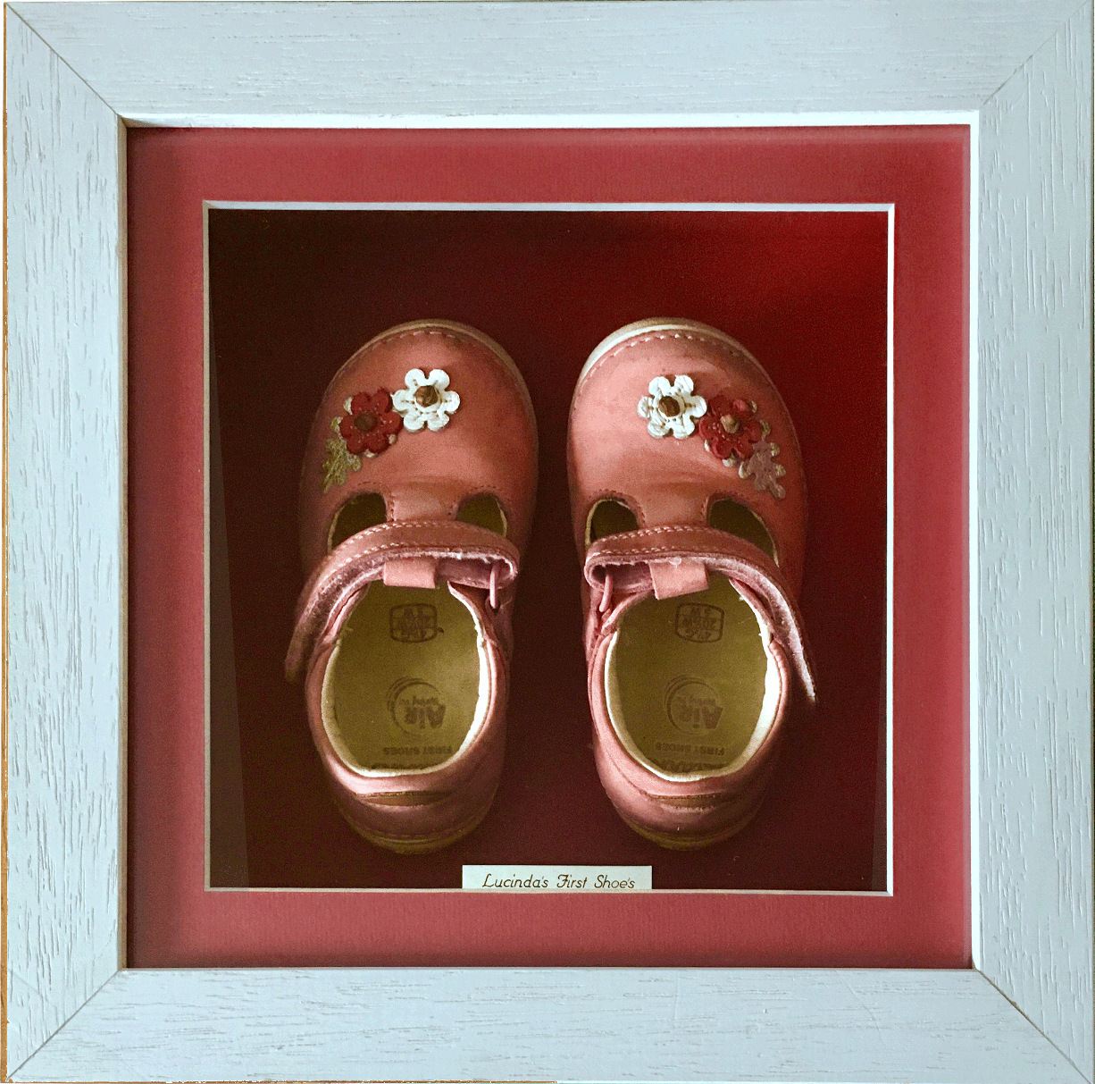 Baby's first pink shoes in wooden box frame