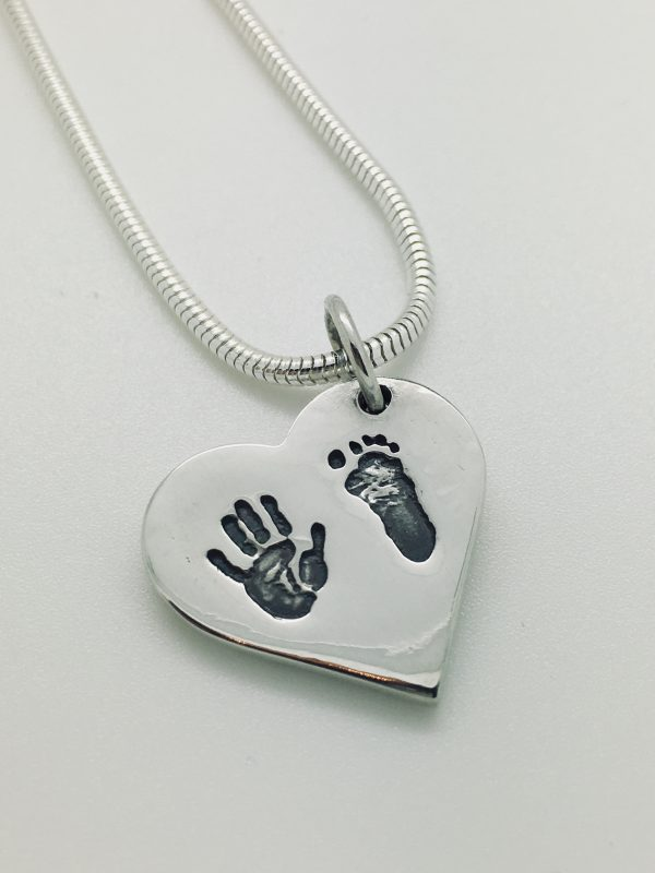silver personalised charm with baby hand and foot print