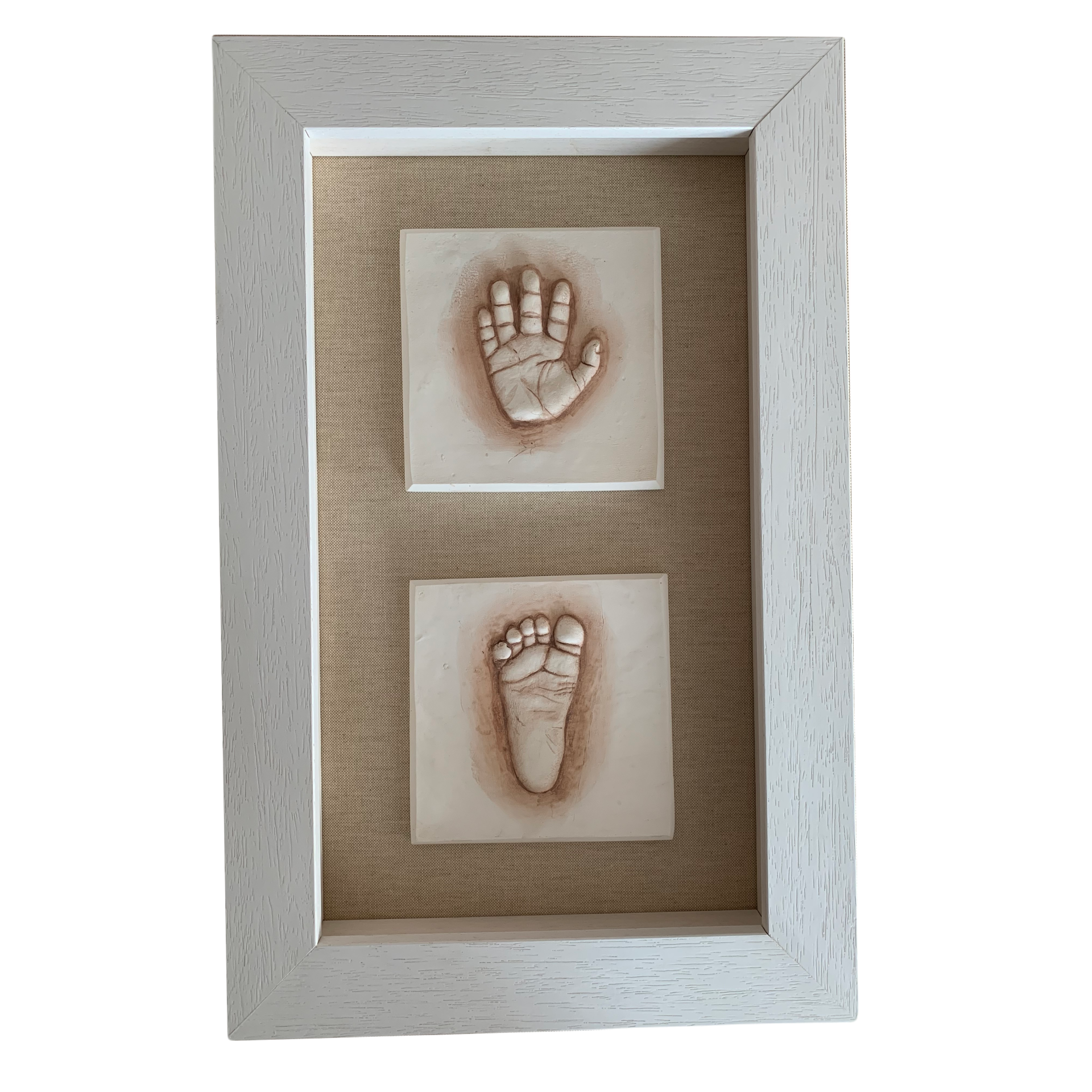 Baby hand and foot impressions in clay mounted in a wooden frame