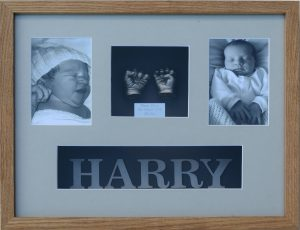 Baby life castings with photograph and name