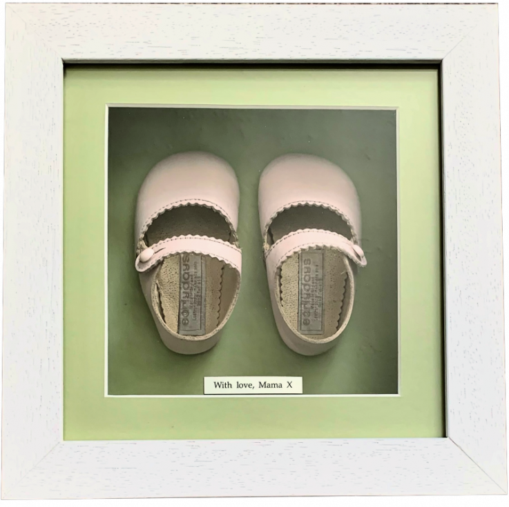 Pink first baby shoes in box frame