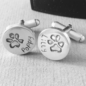 paw prints impressions stamped onto silver cuff links