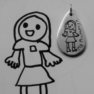 Childs drawing on a silver charm - personlaised jewllery