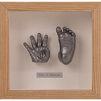 Baby hand and foot casting in a wooden frame