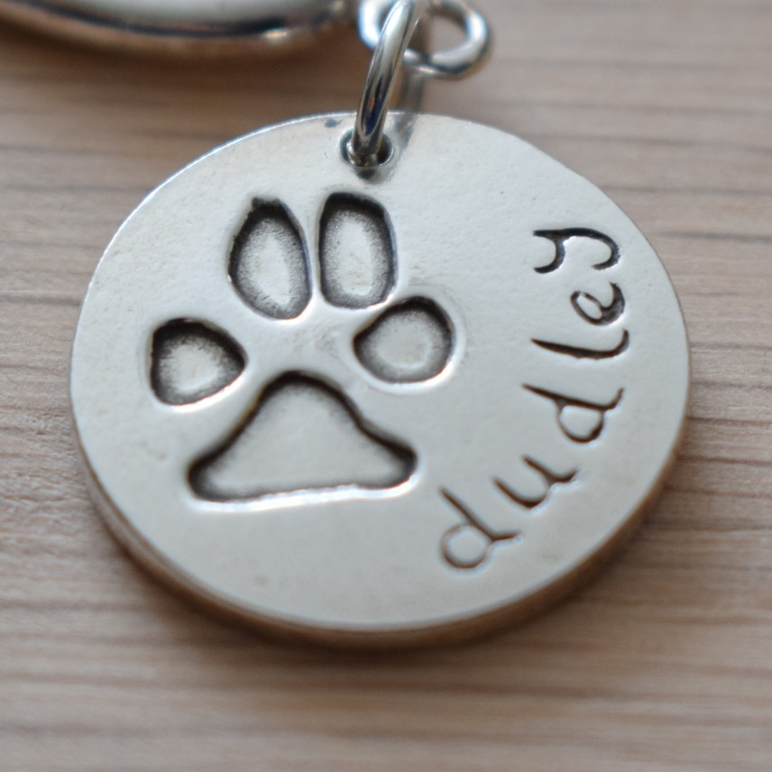 Large silver charm of dog paw print in silver