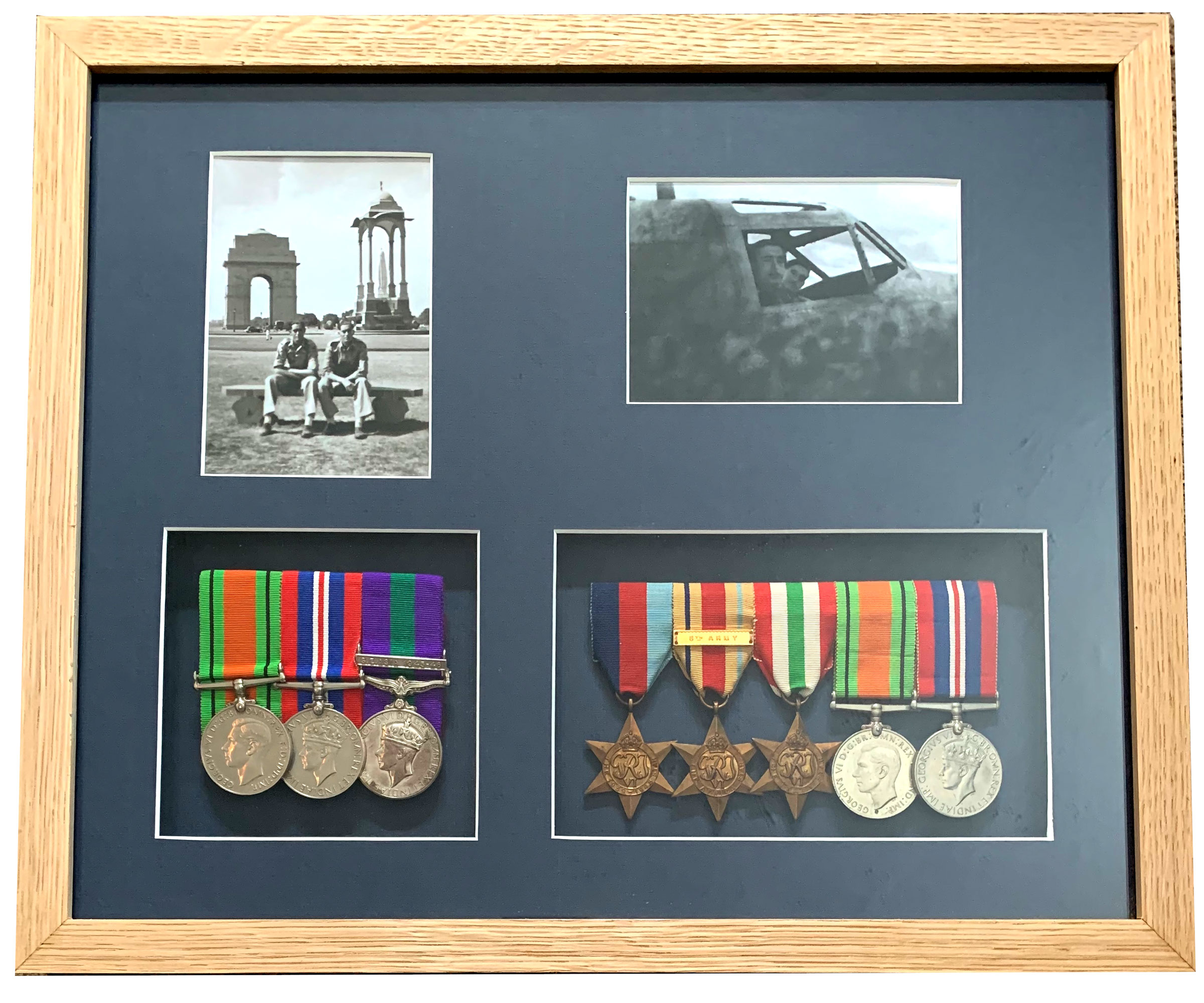 medals framed with photographs