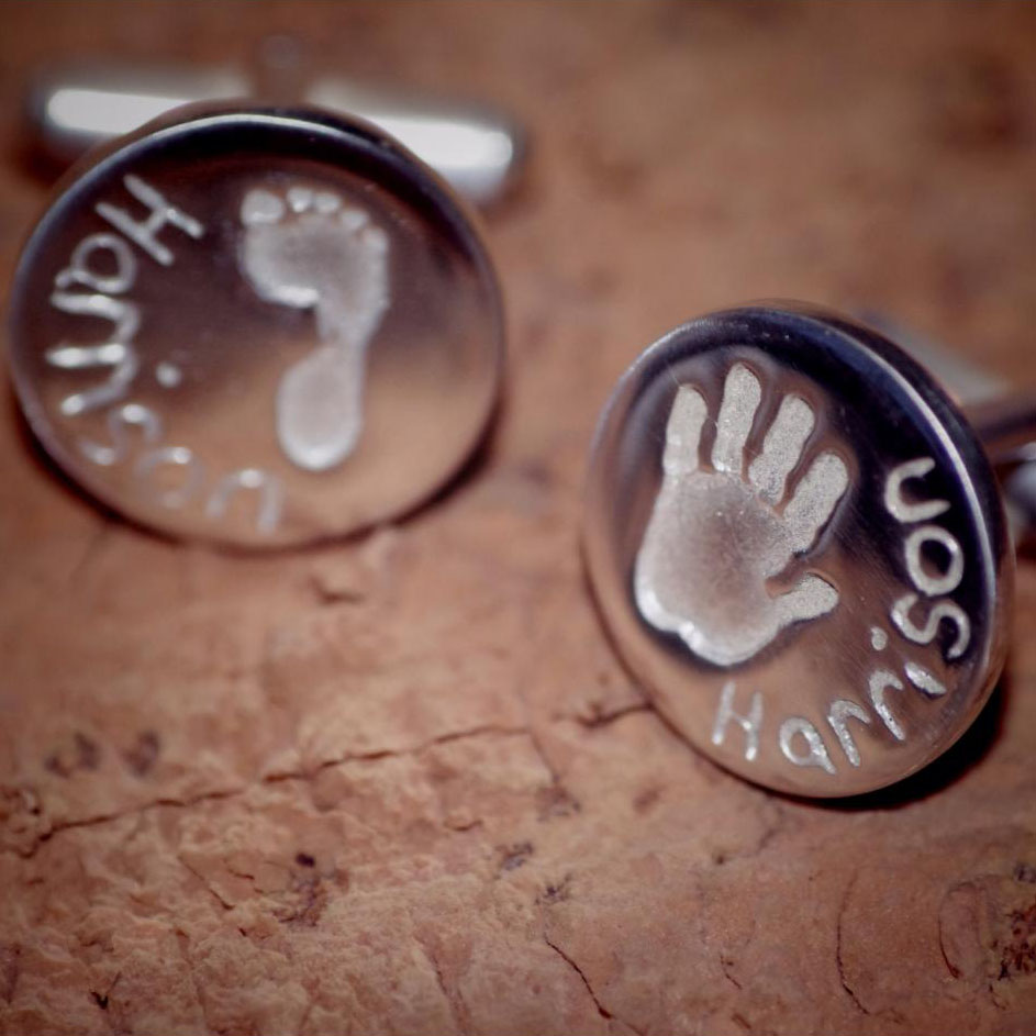 think silver cufflinks with child's hand and foot print with name