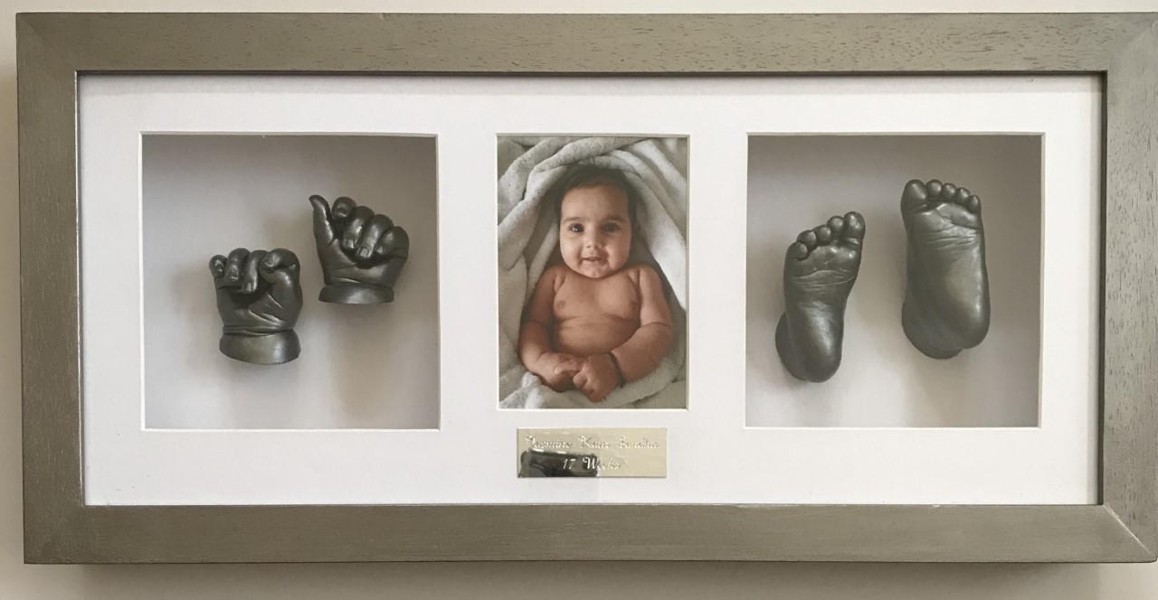 Framed baby hand and feet casts with photo framed