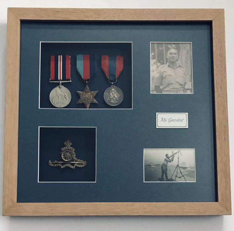 war medals and photographs framed in a specialist oak frame