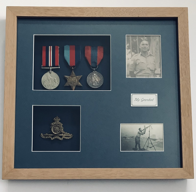 war medals and photos framed